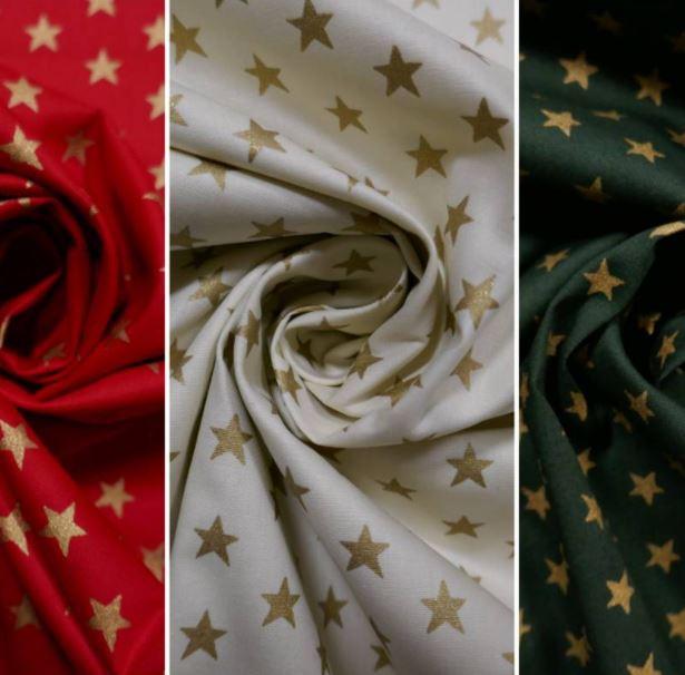 Tela navideña algodón con estrellas doradas